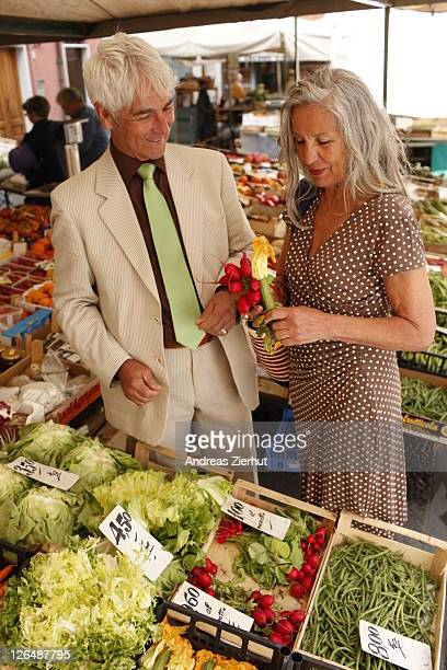 Senior couple on a vegetable market, Italy