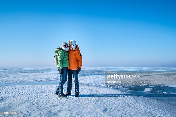 senior couple on big open ice area like arctic