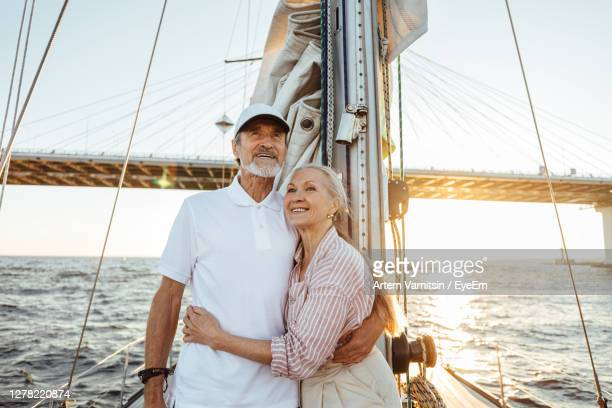 senior couple on boat at sea against sky - married stock pictures, royalty-free photos & images