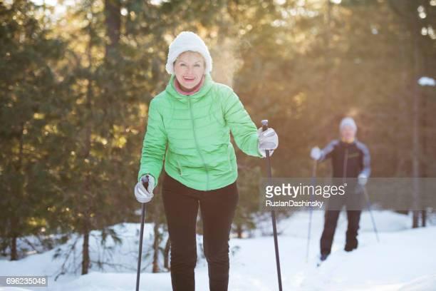 Senior couple on cross-country ski sport training.