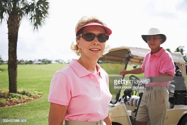 Senior couple on golf course, portrait