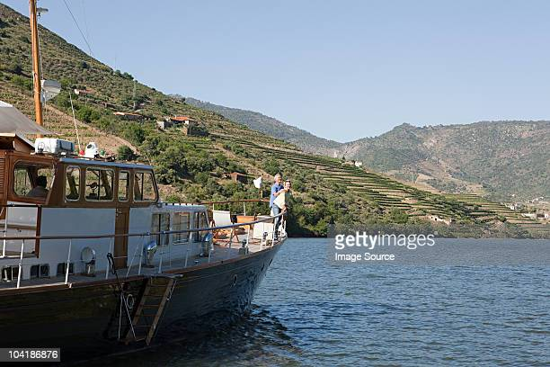senior couple on holiday on boat - douro valley stock photos and pictures