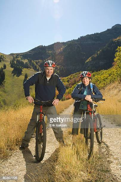 senior couple on mountain bikes, utah, united states - steep stock photos and pictures