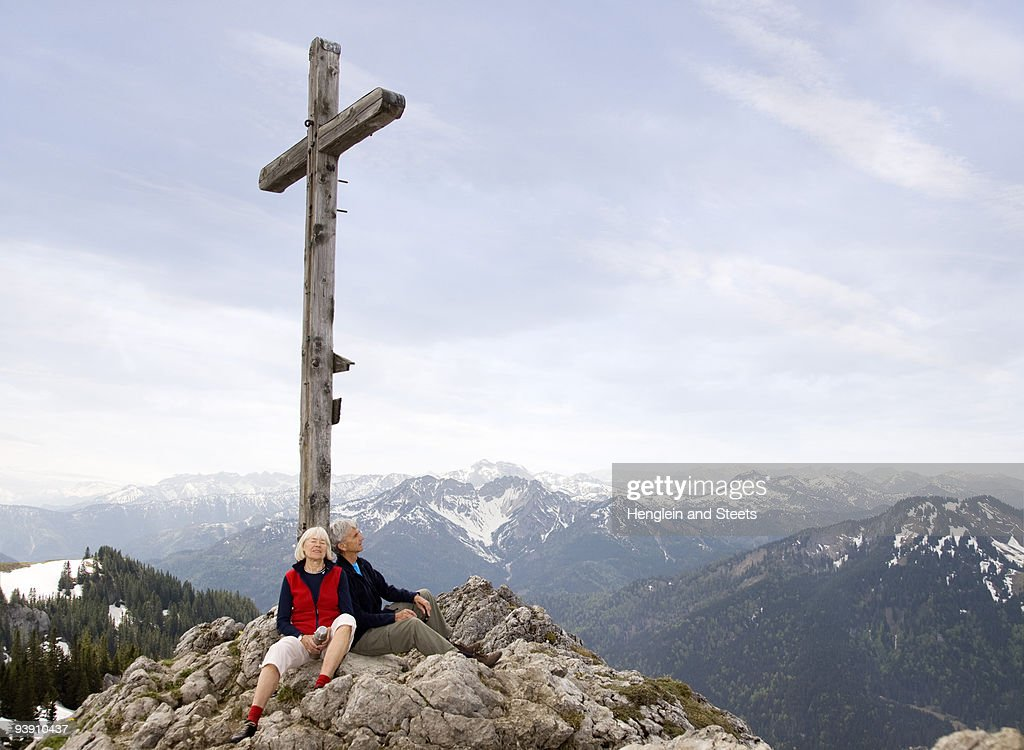 senior couple on mountain summit : Stock Photo