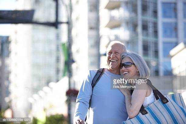 Senior couple on street, laughing