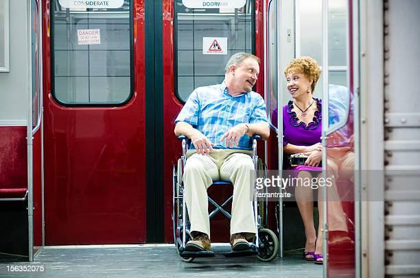 Senior Couple on Subway Train Wheelchair Access