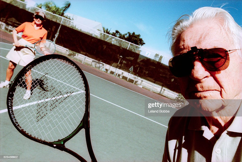 Senior Couple on Tennis Court : Stock Photo