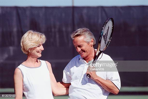 senior couple on tennis court - doubles sports competition format stock pictures, royalty-free photos & images
