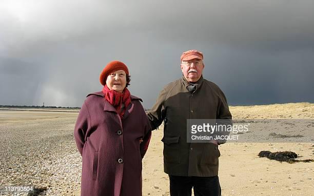 Senior couple on the beach in winter