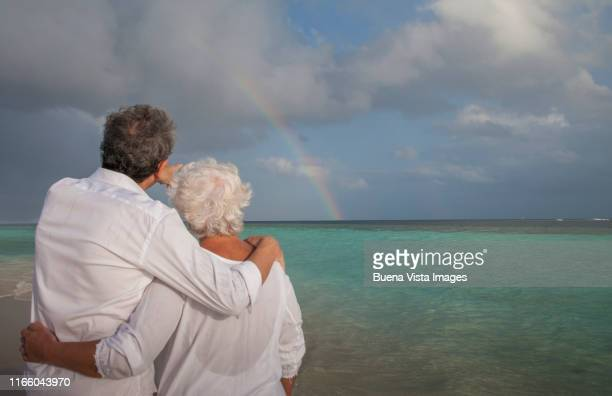 senior couple on the beach. - vilamendhoo stock photos and pictures