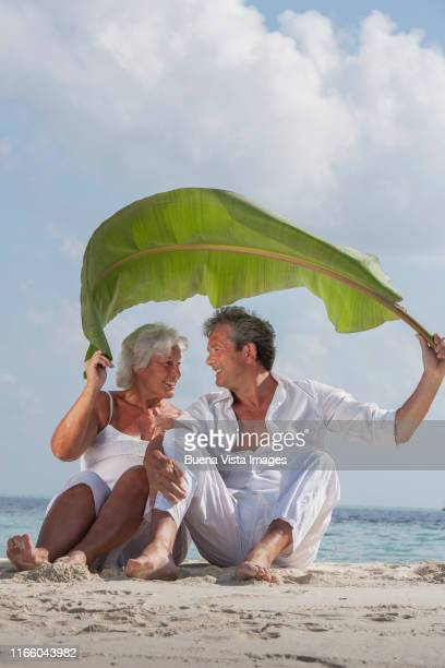 senior couple on the beach - vilamendhoo stock photos and pictures