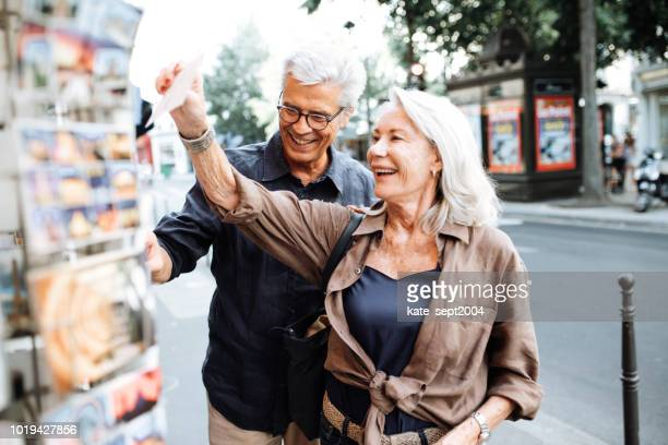 senior couple on vacation in france - life insurance stock pictures, royalty-free photos & images