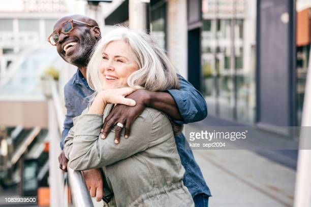 senior couple on vacation - mixed race person stock pictures, royalty-free photos & images