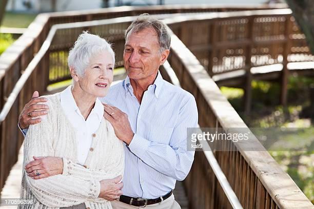 Senior couple on wooden walkway