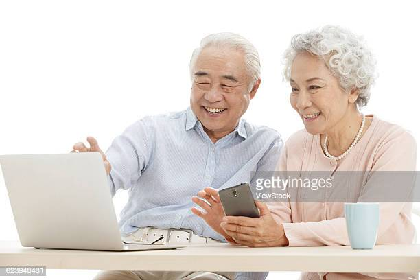 Senior couple online shopping with credit card in home