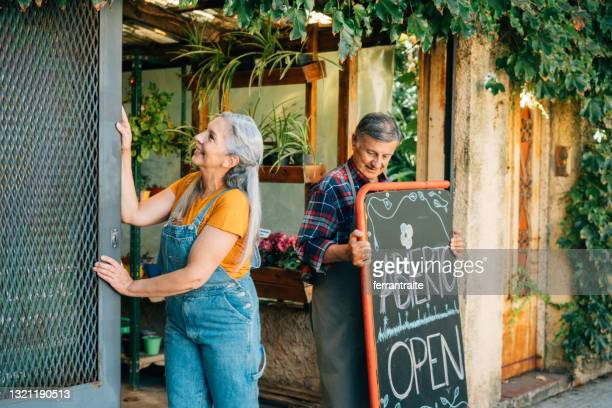senior couple opening small business - day 1 stock pictures, royalty-free photos & images
