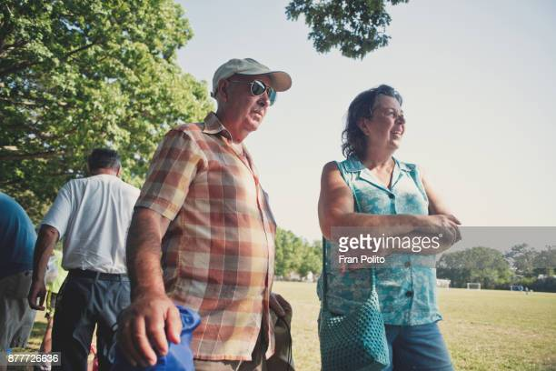 senior couple outdoors at a field. - tree man syndrome stock photos and pictures