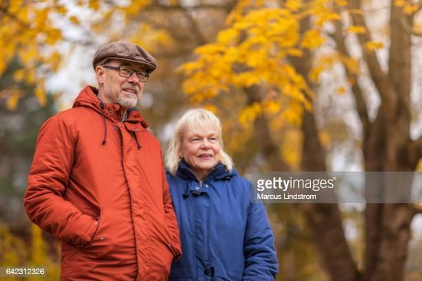 Senior couple outdoors on an autumn day