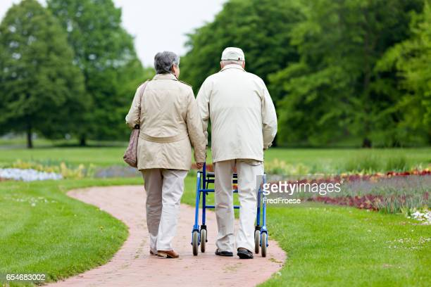 senior couple outdoors - osteoporosis stock photos and pictures