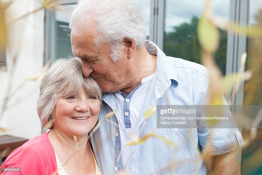 Senior couple outdoors together : Stock Photo
