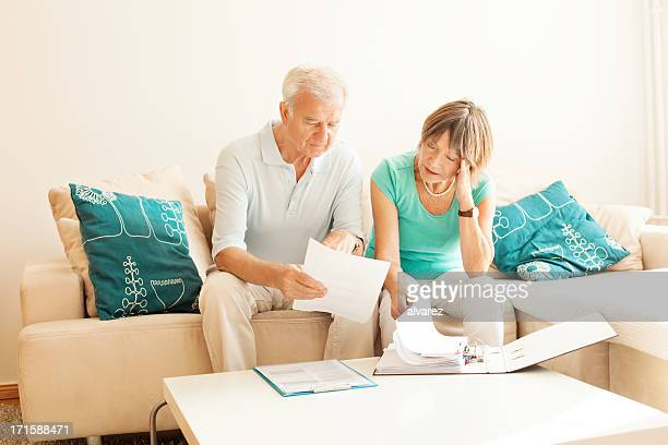 Senior couple overwhelmed with paperwork