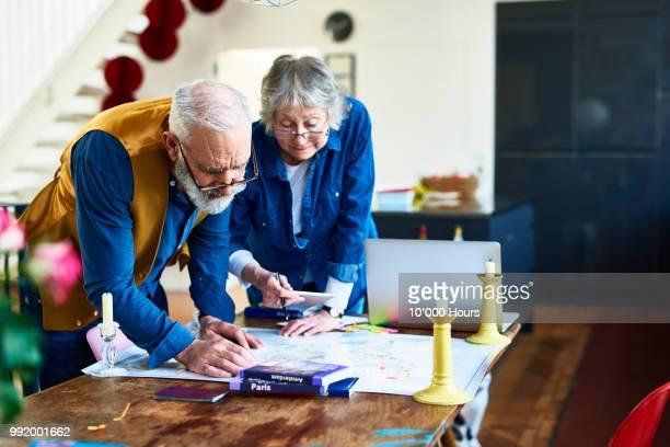 Senior couple planning round the world adventure