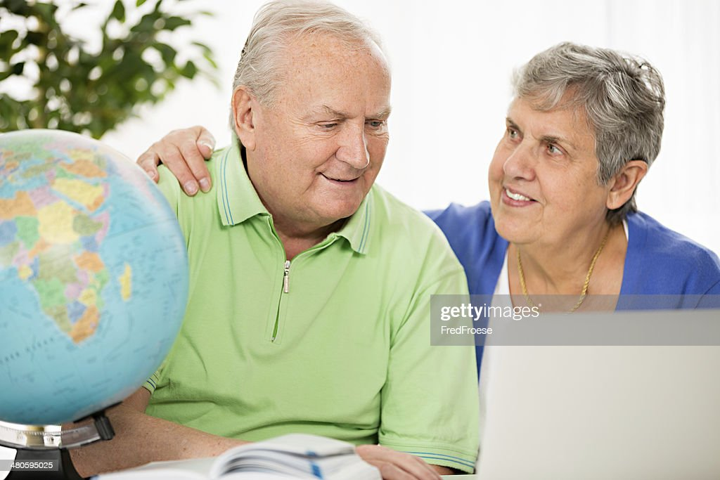 Senior couple planning travel destination : Stock Photo