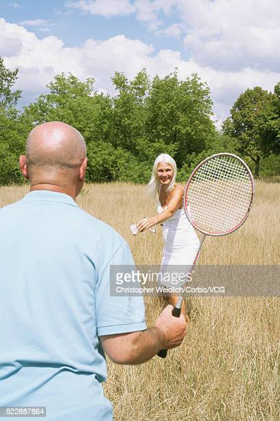 Senior couple playing badminton