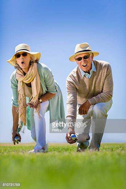 Senior couple playing bocce ball game