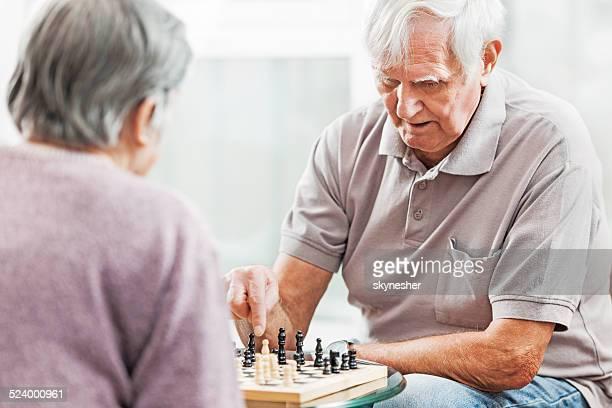 Senior couple playing chess.