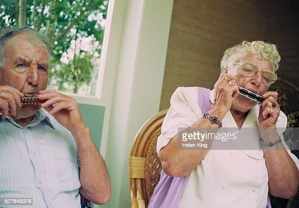 Senior Couple Playing Harmonicas