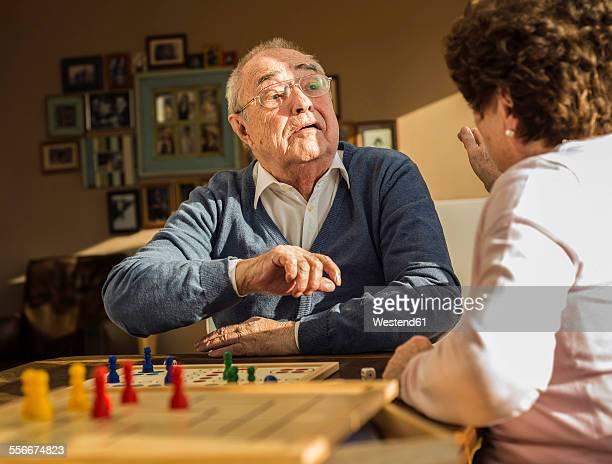 Senior couple playing ludo