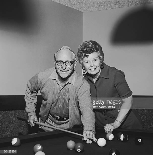 senior couple playing pool, smiling, portrait - old men playing pool stock pictures, royalty-free photos & images