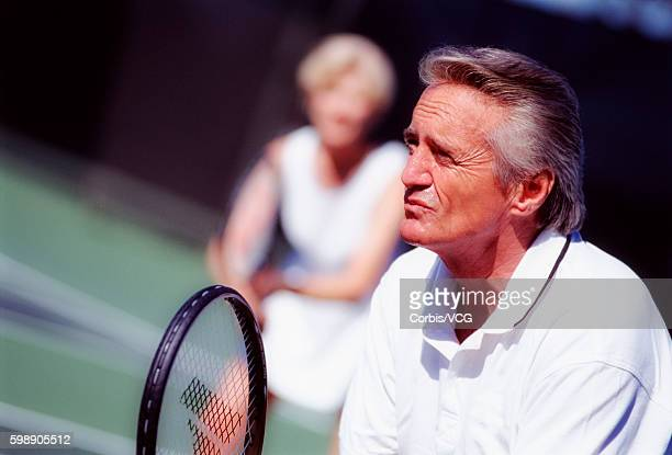 senior couple playing tennis - doubles sports competition format stock pictures, royalty-free photos & images