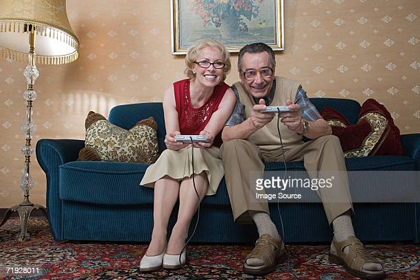 Senior couple playing video game