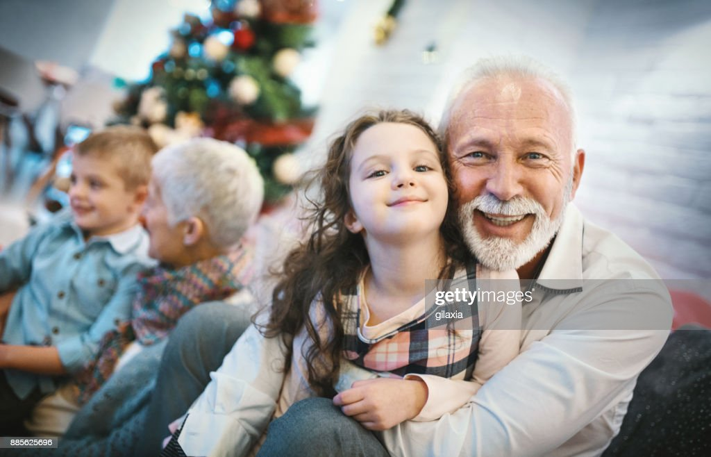 Senior couple playing with grandchildren. : Stock Photo