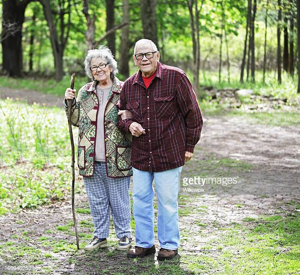 senior couple portrait on nature trail - fat granny stock pictures, royalty-free photos & images