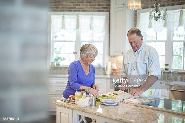 Senior couple preparing sandwiches