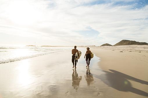 Senior couple preparing to go surfing - gettyimageskorea