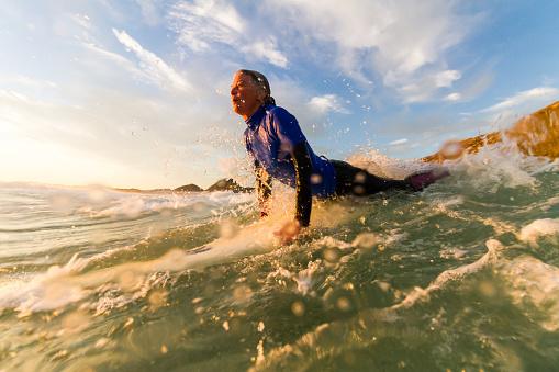 Senior couple preparing to surf together - gettyimageskorea