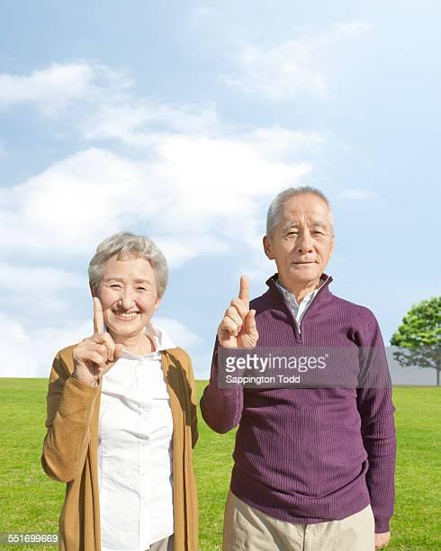 Senior Couple Raising Finger