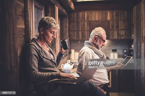 Senior couple reading on digital device