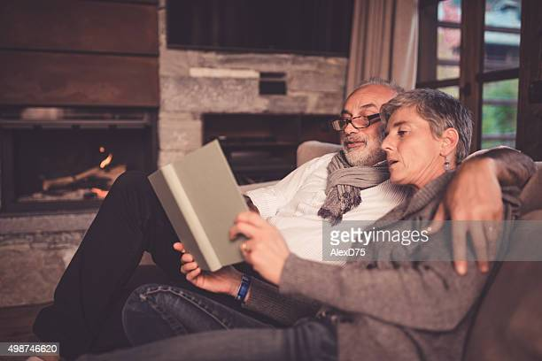 Senior Couple Reading on Sofa