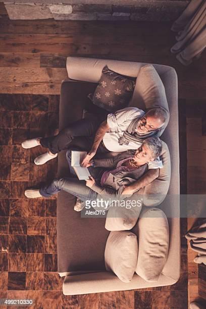 Senior Couple Reading on Sofa