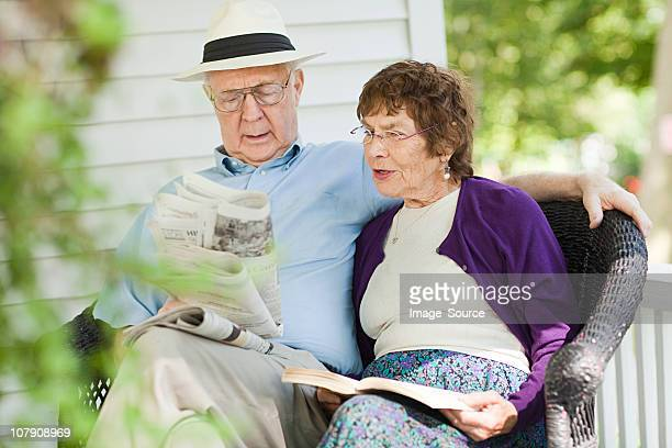 senior couple reading - purple hat stock pictures, royalty-free photos & images