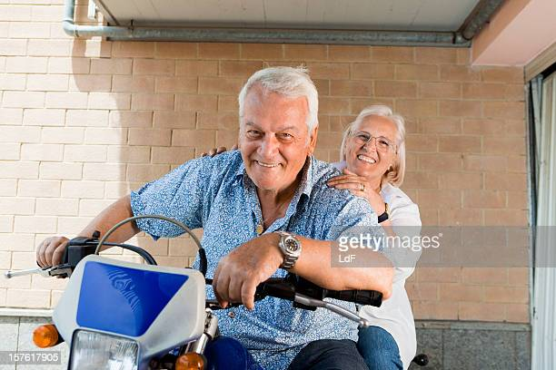 Senior couple ready for a motorbike ride