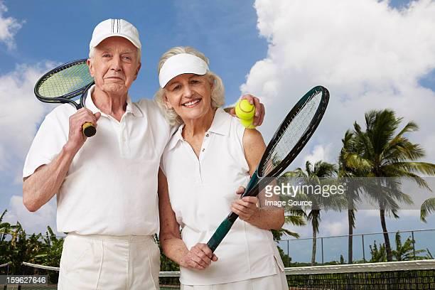 Senior couple ready for tennis