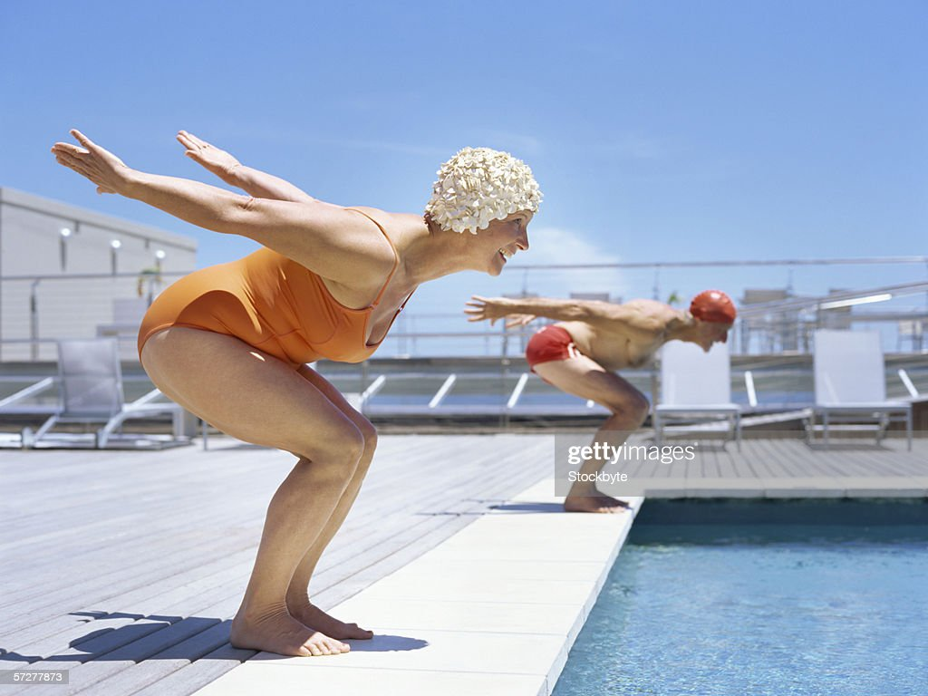 Lovely Senior Couple Ready To Dive In To Swimming Pool : Stock Photo