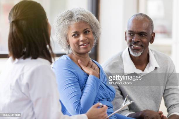 Senior couple receive good news from doctor