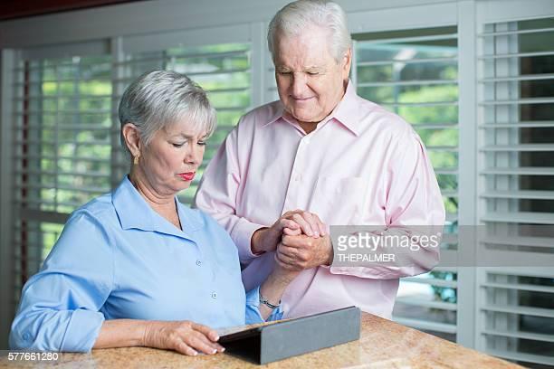 Senior couple receiving bad news